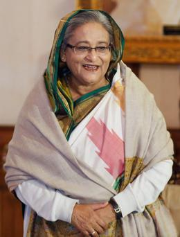 Bangladesh's Prime Minister Sheikh Hasina arrives for a media conference in Dhaka