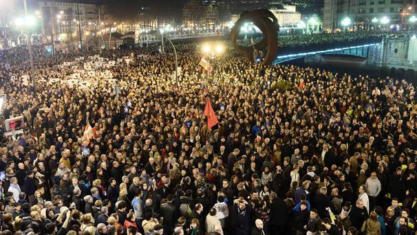 Thousands of people march take part in a demonstration in Bilbao
