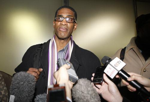 Former NBA basketball player Charles Smith is surrounded by journalists as he arrives at Beijing Capital International Airport from North Korea's Pyongyang. Dennis Rodman lead six former NBA players played a basketball game with North Korean basketball players on January 8 in Pyongyang, as a birthday present for North Korean leader Kim Jong Un. (Photo by ChinaFotoPress/ChinaFotoPress via Getty Images)