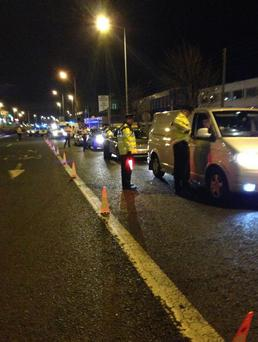 Checkpoint on Naas Road, Dublin 11/12th January. The official An Garda Siochana Twitter account posted this photo with the numbers, '10 Gardaí, 208 vehicles, 45 Breath Tests, No arrests.' (Photo: @GardaTraffic )