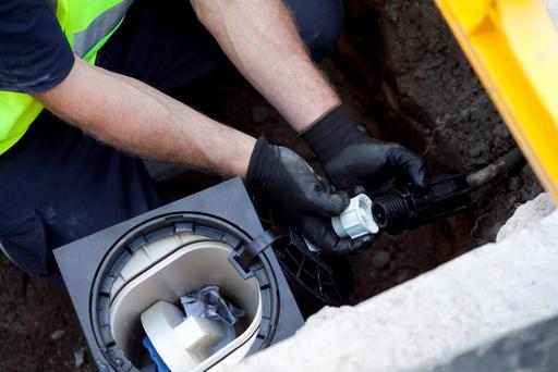 The first Irish Water meter being installed in Maynooth, Co. Kildare in August, 2013. Photo: Colm Mahady / Fennells.