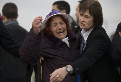 A woman cries as former Israeli Prime Minister Ariel Sharon lies in state at Knesset Plaza in Jerusalem, Israel.