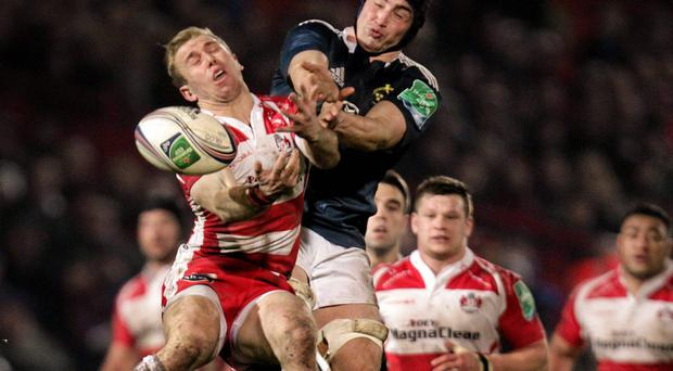 Tommy O'Donnell, Munster,contends for the ball with Dan Robson, Gloucester