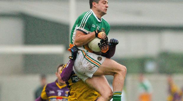 Offaly's Niall Smith in action against Brian Malone of Wexford during the O'Byrne Cup Game in Tullamore