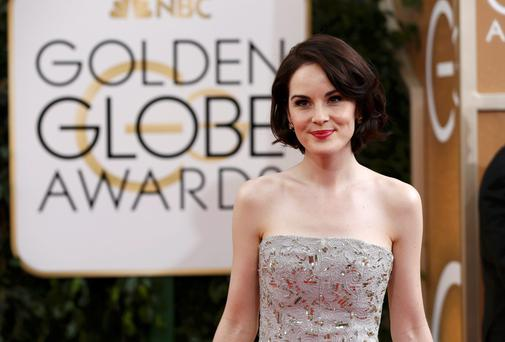 Actress Michelle Dockery, of the drama series Downton Abbey, arrives at the 71st annual Golden Globe Awards in Beverly Hills, California