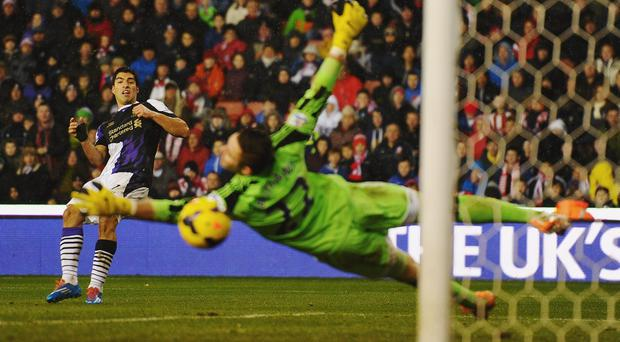 Luis Suarez scores for Liverpool against Stoke city