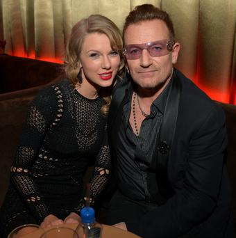 BEVERLY HILLS, CA - JANUARY 12: Singer Taylor Swift (L) and musician Bono attend The Weinstein Company & Netflix's 2014 Golden Globes After Party presented by Bombardier, FIJI Water, Lexus, Laura Mercier, Marie Claire and Yucaipa Films at The Beverly Hilton Hotel on January 12, 2014 in Beverly Hills, California. (Photo by Charley Gallay/Getty Images for The Weinstein Company)