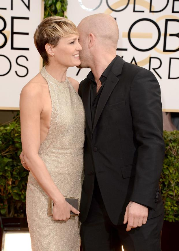 Robin Wright and Ben Foster attend the 71st Annual Golden Globe Awards held at The Beverly Hilton Hotel on January 12, 2014 in Beverly Hills, California.