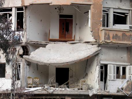 Damaged buildings are pictured in the besieged area of Homs yesterday. Photo: REUTERS/Thaer Al Khalidiya