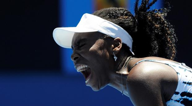 Venus Williams of the U.S. yells in frustration during her first round loss to Ekaterina Makarova of Russia at the Australian Open tennis championship in Melbourne