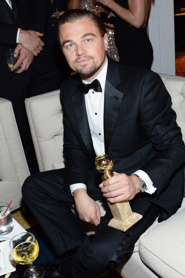 Leonardo DiCaprio keeps it classy in a well-tailored black tuxedo with Jennifer Meyer cuff-links. (Photo by Araya Diaz/Getty Images for The Weinstein Company)