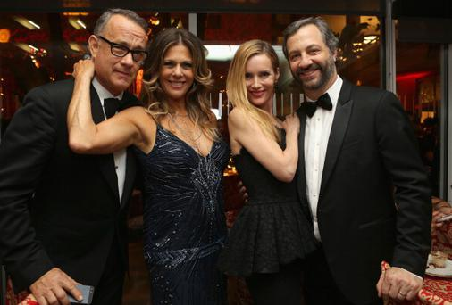 (L-R) Actor Tom Hanks, actress Rita Wilson, actress Leslie Mann, and producer/director Judd Apatow