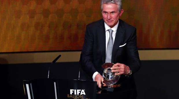 ZURICH, SWITZERLAND - JANUARY 13: Jupp Heynckes of Germany receives the FIFA coach of the year trophy during the FIFA Ballon d'Or Gala 2013 at the Kongresshalle on January 13, 2014 in Zurich, Switzerland. (Photo by Martin Rose/Bongarts/Getty Images)