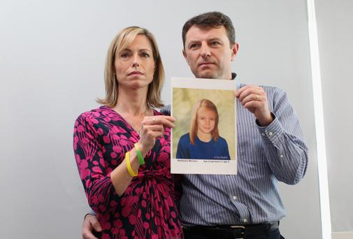 Kate and Gerry McCann hold an age-progressed police image of their daughter Madeleine