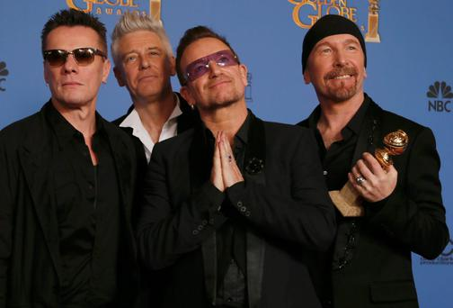 Adam Clayton, Bono, Larry Mullen, Jr., and The Edge (L to R), from U2