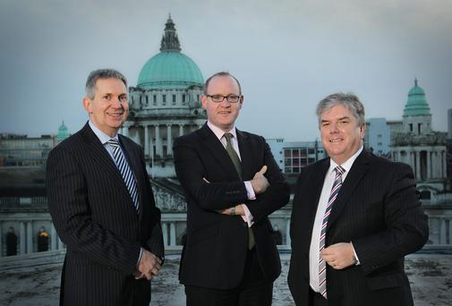 Square Seven directors David Rea (left) and Sam Curry (right); and Stephen Felle, managing director of Davy Private Clients NI. BRIAN THOMPSON/PRESSEYE