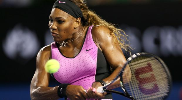 Serena Williams plays a backhand in her first round match against Ashleigh Barty