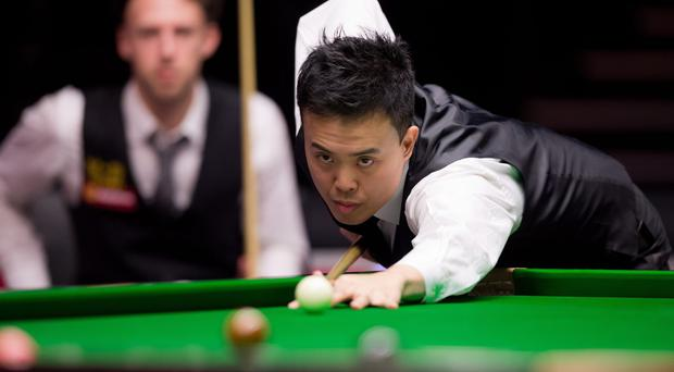 Marco Fu of Hong Kong is pictured during the match against Great Britain's Judd Trump