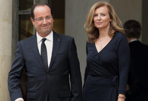 France's President Hollande and his companion Valerie Trierweiler outside the Elysee Palace. She was rushed to hospital after news of the affair broke.