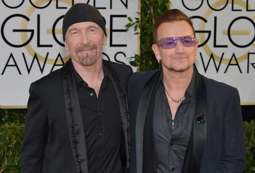 The Edge and Bono arrive at the 71st annual Golden Globe Awards at the Beverly Hilton Hotel on Sunday, Jan. 12, 2014. Photo: John Shearer/Invision/AP