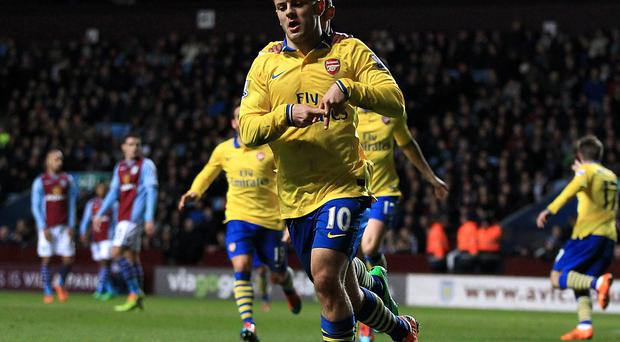 Arsenal's Jack Wilshere celebrates scoring his team's opening goal during the Barclays Premier League match at Villa Park. Photo: PA