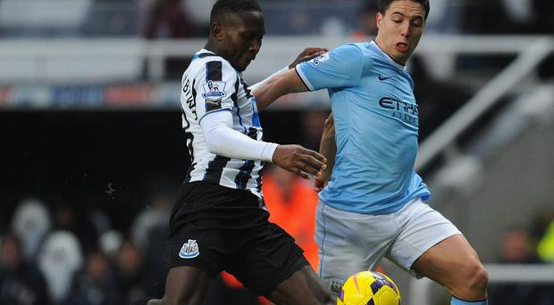 Manchester City midfielder Samir Nasri (r) will miss the next two months due to a knee injury