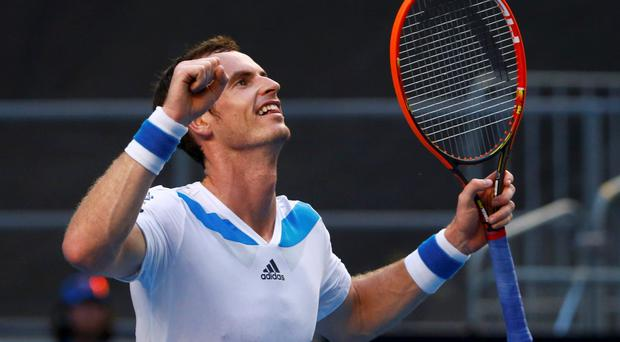 Andy Murray of Britain celebrates defeating Go Soeda of Japan during their men's singles match at the Australian Open 2014 tennis tournament in Melbourne