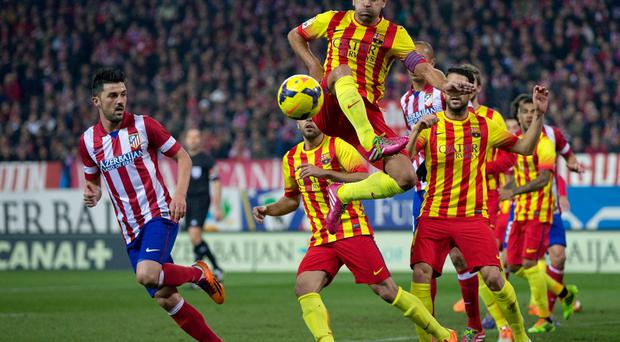 Xavi Hernandez of FC Barcelona controls the ball during the La Liga match between Club Atletico de Madrid and FC Barcelona at the weekend