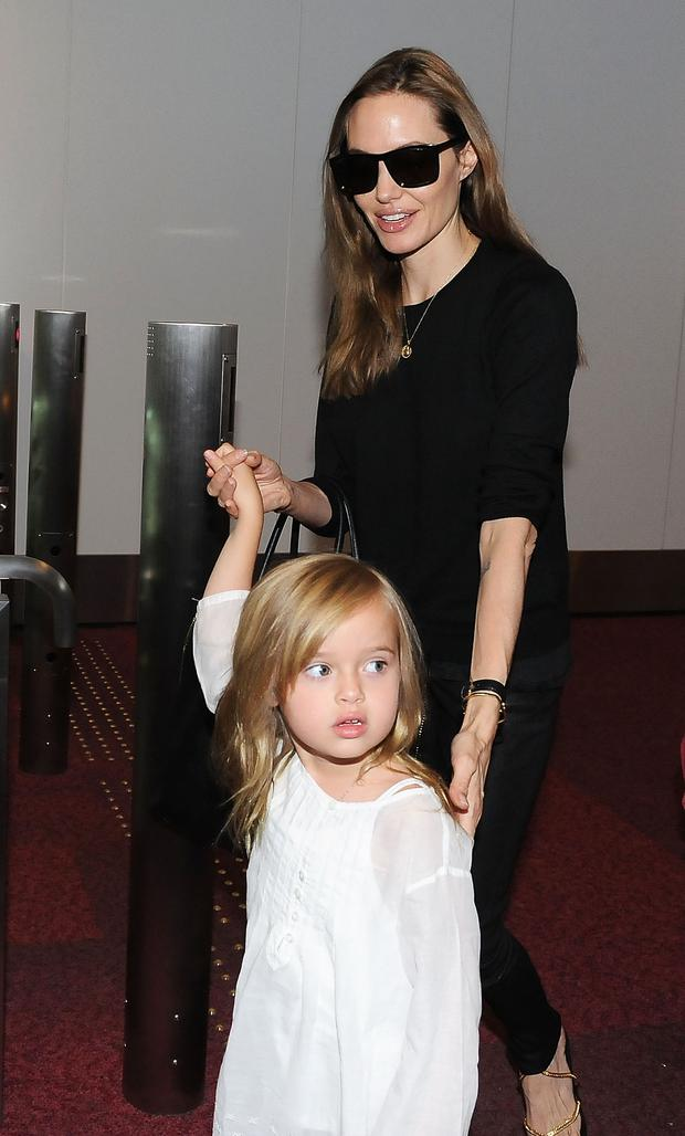 Angelina Jolie and Vivienne Jolie-Pitt arrive at Tokyo International Airport (Photo by Jun Sato/WireImage)