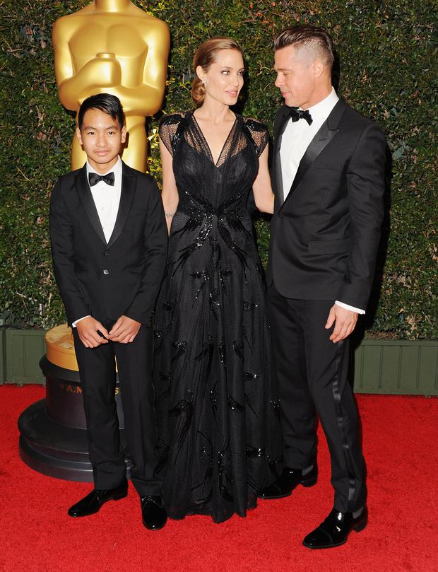 Actor Brad Pitt, actress Angelina Jolie and son Maddox Jolie-Pitt arrive at The Academy Of Motion Picture Arts And Sciences' Governor Awards, California. (Photo by Jon Kopaloff/FilmMagic)