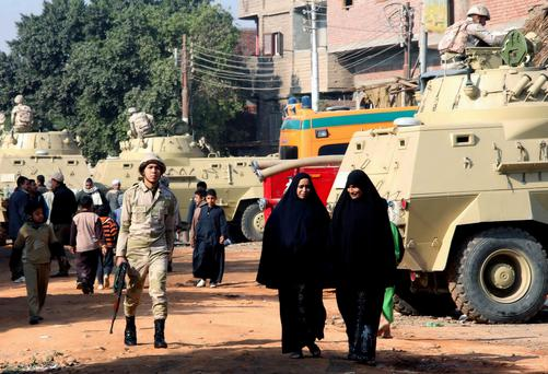 Egyptian military soldiers patrol streets during the country's constitutional referendum near a polling station in Dalga, Minya province, Egypt