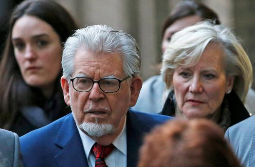 Entertainer Rolf Harris leaves Southwark Crown Court in London January 14, 2014. Harris appeared in court on Tuesday to enter a plea to 16 offences dating back to the 1980s, one allegedly involving a girl aged seven or eight. REUTERS/Suzanne Plunkett (BRITAIN - Tags: ENTERTAINMENT CRIME LAW)