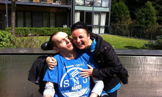 Christy, pictured with a carer, suffers from Huntington's disease.