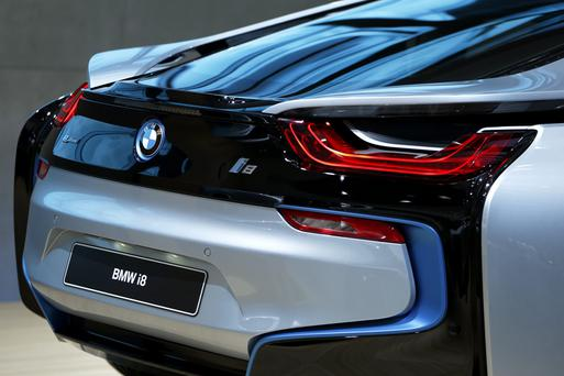 A BMW i8 electric sports vehicle sits on display at the 43rd Tokyo Motor Show 2013 in Tokyo. In future car badges will display power or emissions. Photo: Kiyoshi Ota/Bloomberg