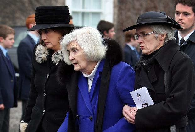 Attending the requiem mass of The Hon. Mr. Justice Anthony J. Hederman at St Vincents Castleknock College yesterday was his sister Miriam O'Brien (centre).