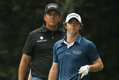 Phil Mickelson, left, looks over Rory McIlroy, of Northern Ireland, shoulder on the 14th fairway during the first round of the U.S. Open in 2011. Picture: Matt Slocum