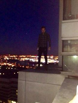 The photo of Liam on the edge of the 34-story building was posted on Twitter.