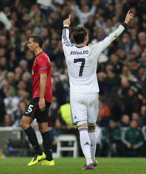 Cristiano Ronaldo of Real Madrid celebrates scoring their first goal against Manchester United last season.