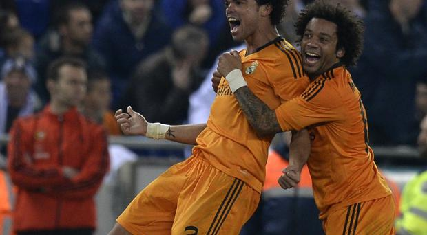 Real Madrid's Pepe celebrates with team-mate Marcelo after scoring the winning goal against Espanyol