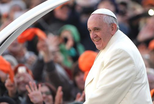 Pope Francis gestures to the crowds at St. Peter's square yesterday