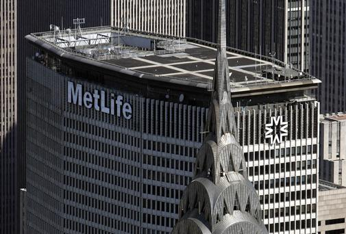 Aerial view of the Chrysler Building (foreground) and the Met Life Building (rear) in midtown Manhattan 01 July 2007 in New York City. Phboto: STAN HONDA/AFP/Getty Images
