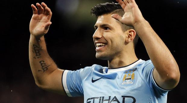 Manchester City's Sergio Aguero celebrates scoring during their FA Cup third round soccer match against Blackburn Rovers at the Etihad stadium in Manchester, northwest England January 15, 2014. REUTERS/Phil Noble (BRITAIN - Tags: SPORT SOCCER)