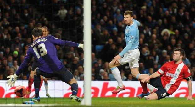 Edin Dzeko scores his team's fifth goal