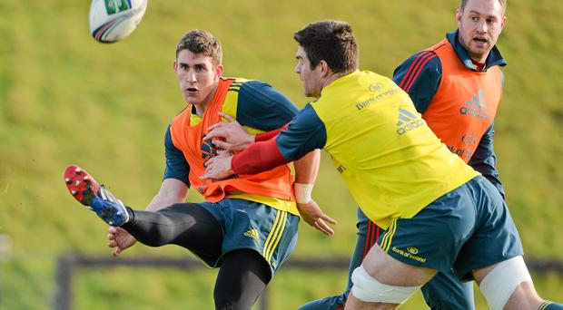 15 January 2013; Munster's Ian Keatley in action against Billy Holland during squad training ahead of their Heineken Cup 2013/14, Pool 6, Round 6, match against Edinburgh on Sunday. Munster Rugby Squad Training, University of Limerick, Limerick. Picture credit: Diarmuid Greene / SPORTSFILE