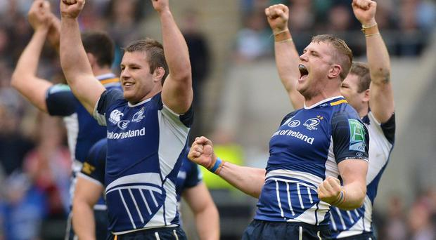 Leinster's Sean O'Brien, left, Jamie Heaslip and Gordon D'Arcy, right, celebrate after the final whistle at the Heineken Cup Final in 2012 Matt Browne / SPORTSFILE