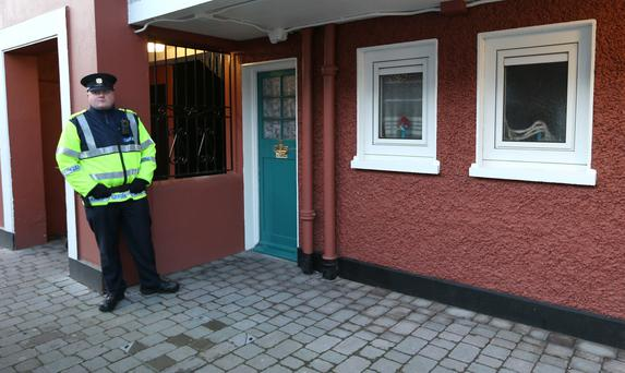 A Garda stands outside 90 O'Rahilly house in Ringsend where a woman was injured in a gas explosion last night. Picture credit; Damien Eagers/ Herald 16/1/2014