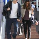 LOS ANGELES, CA - SEPTEMBER 29: Mila Kunis and Ashton Kutcher arrive at LAX (Los Angeles International Airport). on September 29, 2013 in Los Angeles, California. (Photo by GVK/Bauer-Griffin/GC Images)