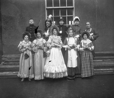 From the Archives: This picture was taken at a boys school at an unknown location. The boys are dressed up for a play. Can you help us put a name and place to this picture? <a href=