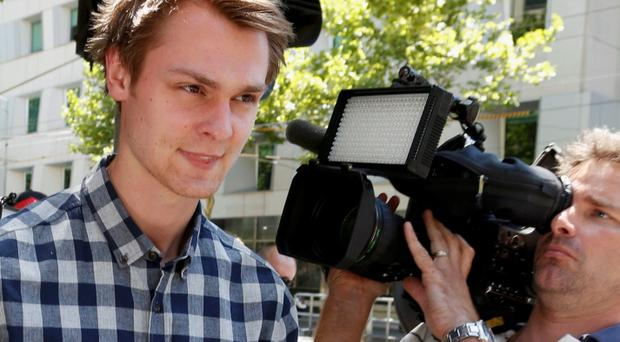 Daniel Dobson, a 22-year-old Briton arrested during an Australian Open 2014 tennis match at Melbourne Park on Tuesday, leaves Melbourne Magistrates' Court