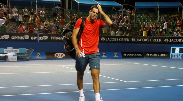 Juan Martin Del Potro of Argentina leaves after being defeated